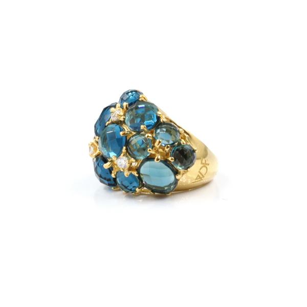 Anel em prata dourada, 925, com pedras hidrotermais azuis e zircônias